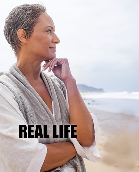 Senior Black Woman Relaxing on Beach